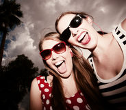 Fashion Girls Against a Cloudy Sky Stock Images
