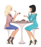 Fashion girls at a cafe. Two girls at a cafe talking and looking on each other Royalty Free Stock Images