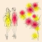 Fashion girls  on a floral background Royalty Free Stock Image