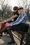 Fashion girls relaxing after shopping Stock Photos