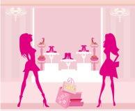 Fashion girls shopping in shoe shop Royalty Free Stock Photo