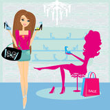 Fashion girls shopping in shoe shop Stock Photo