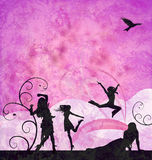 Fashion girls silhouettes on grunge pink Royalty Free Stock Photo
