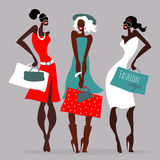 Fashion girls. Women with shopping bags. Royalty Free Stock Photo