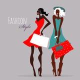 Fashion girls. Women with shopping bags. Stock Photo