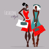 Fashion girls. Women with shopping bags. Royalty Free Stock Photography