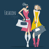 Fashion girls. Women with shopping bags. Royalty Free Stock Images