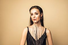 Fashion glamor woman with face in glitter powder. royalty free stock images
