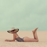 Fashion Glamorous Lady on vacation at the beach stock photos