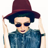 Fashion glamorous lady in a vintage hat and glasses royalty free stock photography