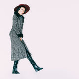 Fashion glamorous model in a vintage hat and coat Stock Images