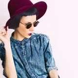 Fashion glamorous model in a vintage hat and glasses Stock Photos