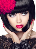 Fashion Glamour Beauty Model Girl with Makeup and bob short Hair. Black hairstyle. Closeup portrait of brunette young woman Royalty Free Stock Photography