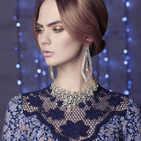 Fashion glamour girl in christmas decorated interior Royalty Free Stock Photo