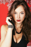 Fashion glamour girl with jewellery on red vintage background Royalty Free Stock Photos