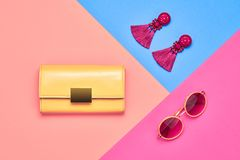 Fashion Minimal woman Accessories. Pastel color. Fashion Glamour Summer Lady. Trendy Pink Handbag Clutch. Stylish Summer Sunglasses, Earrings. Vintage Party royalty free stock images