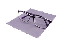 Fashion glasses with glasses cleaning cloth. Isolate on white. Stock Photos