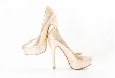 Fashion gold female high heeled shoes Royalty Free Stock Images