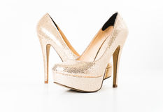 Fashion gold female high heeled shoes Stock Image