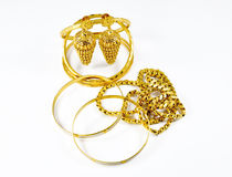 Fashion Gold Jewellery. Gold jewellery  on white background Stock Photography