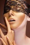 Fashion gold make up on sensual woman Stock Photos