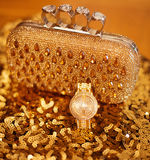 Fashion golden womens accessories. Luxury wristwatch and purse, Royalty Free Stock Photography
