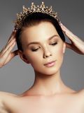 Fashion gorgeous woman in diamond crown, beauty contest winner. Luxury girl with bright makeup. Elegant fashionable lady in studio, vogue style female. Fashion Royalty Free Stock Photography