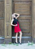 A fashion gothic style portrait of a beautiful blonde girl royalty free stock photography