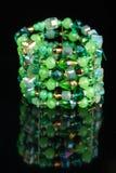 Fashion green bracelet on black Royalty Free Stock Image
