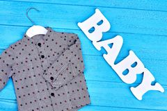 Fashion grey baby-boy cotton shirt. Collection of new apparel for baby-boy. Little boys modern clothes Stock Image