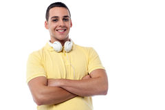 Fashion guy with headphones around his neck Stock Image