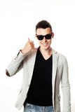 Fashion guy portrait with mobile phone on white background black glasses Stock Photo