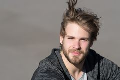 Fashion guy with stylish haircut. Bearded man with long blond hair outdoor. Macho with beard in sportswear on sunny day. Lifestyle. For young man. Mens beauty Stock Image