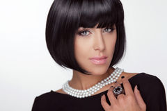 Fashion Haircut. Hairstyle. Sexy Lady.. Stylish Fringe. Short Hair Style. Brunette woman with jewelry pearls Royalty Free Stock Photo