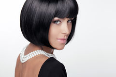 Fashion Haircut. Hairstyle. Sexy Lady.. Stylish Fringe. Short Hair Style. Brunette woman with jewelry pearls Royalty Free Stock Image