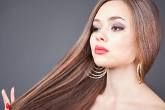 Fashion hairstyle. Beautiful woman with long straight hair Stock Photos