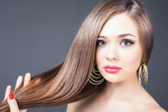 Fashion hairstyle. Beautiful woman with long straight hair Royalty Free Stock Images