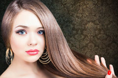 Fashion hairstyle. Beautiful woman with long straight hair. Barbershop. Healthy shampoo. Volume. Beauty. Hair keratin straightening, coloring Stock Image