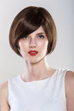 Fashion Hairstyle Glamour Young Woman Portrait. Blue eyes, Red Lips royalty free stock photos