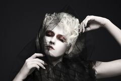 Fashion halloween woman with white skin. Fashion halloween make-up girl with white skin and hair.young woman in veil.black widow style stock image
