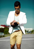 Fashion handsome man in suit in the street Stock Photography