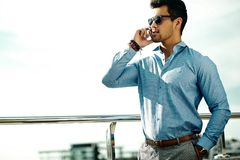 Fashion handsome man in suit in the street Stock Images