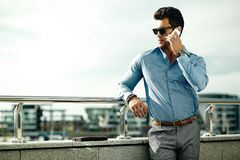 Fashion handsome man in suit in the street Royalty Free Stock Photography
