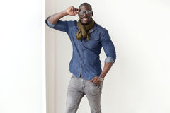 Fashion handsome young man posing at home. Stock Image