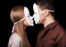 Fashion Happy Couple in Love. Holding with mask face. Psychological concept. Duality look at relationships Royalty Free Stock Images