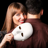 Fashion Happy Couple in Love holding with mask face. Psychological concept. Duality look at relationships Royalty Free Stock Images