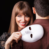 Fashion Happy Couple in Love holding with mask face. Psychological concept. Duality look at relationships Royalty Free Stock Photos