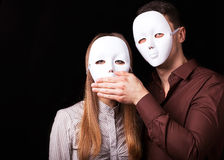 Fashion Happy Couple in Love holding with mask face. Psychological concept. Duality look at relationships Stock Photos