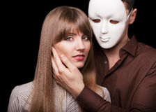 Fashion Happy Couple in Love. Holding a white mask face. Psychological concept. Duality look at relationships Stock Photography