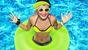 Fashion Happy Girl hot summer party in the pool Stock Image